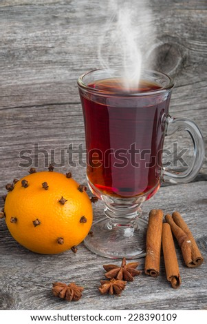 mulled wine and spices with fir branches on wooden table - stock photo