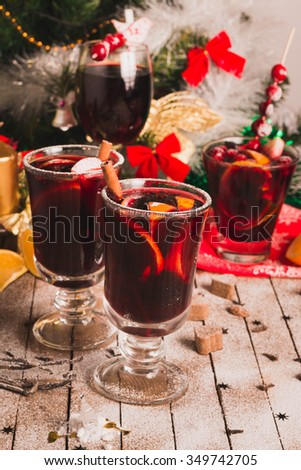 Mulled Wine. Christmas Punch with orange slice and spices  on rustic wood. Selective Focus.