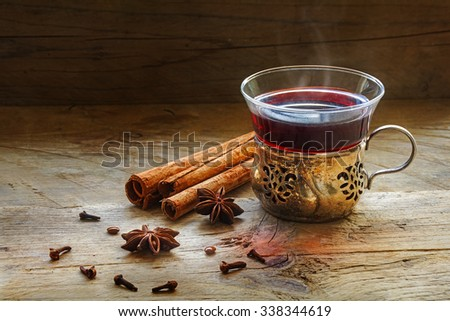 mulled wine, Christmas punch with spices like cinnamon, star anise and cloves on a rustic wooden background - stock photo