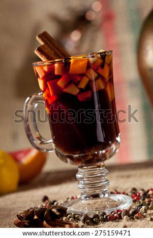 Mulled Wine Cocktail with Cinnamon Stick - stock photo