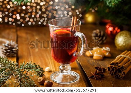 Mulled wine for Christmas Eve celebration party by Christmas tree. Hot traditional winter drink for New Year eve.