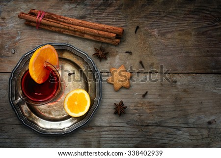mulled wine from above, Christmas punch with orange slice and spices like cinnamon, star anise and cloves on a rustic wooden background, copy space - stock photo