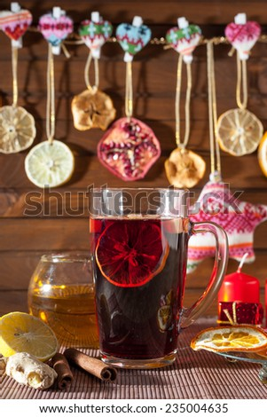 mulled wine in a glass with on a background of Christmas decorations