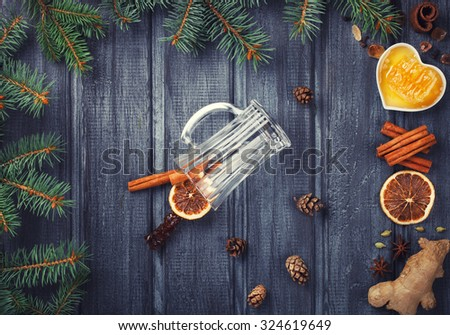Mulled wine,ingredients.Christmas or winter warming drink. Honey, orange, cinnamon sticks, cloves ,ginger,cardamom and sugar.Toned Vintage Christmas Composition.selective focus - stock photo