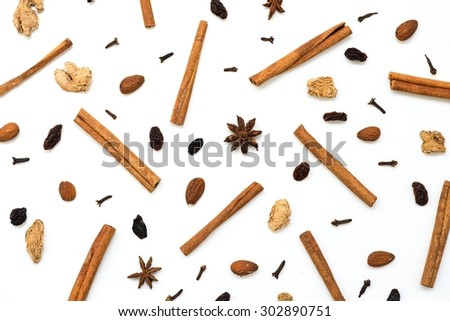 Mulled wine ingredients (cinnamon, anise, raisins, ginger, cloves), top view - stock photo