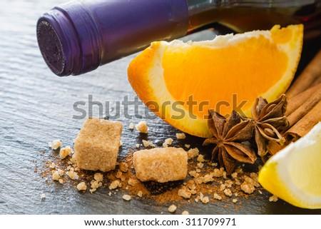Mulled wine ingredients on dark stone background, closeup - stock photo