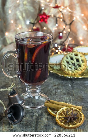 Mulled wine, mince pies and spices on wooden background - stock photo
