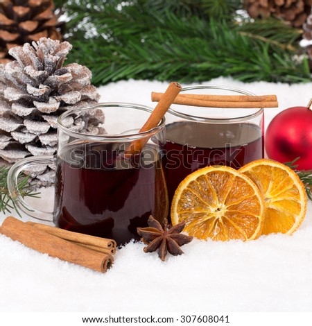 Mulled wine on Christmas in winter alcohol drink with snow - stock photo