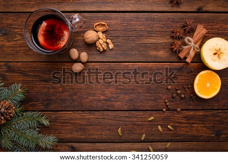 Mulled wine punch and spices for glintwine on vintage wooden table background top view - stock photo