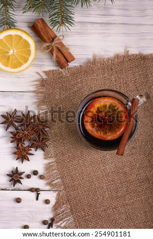 Mulled wine punch and spices for glintwine on wooden background - stock photo