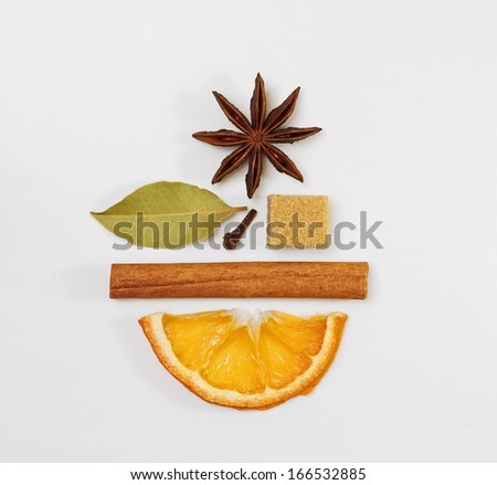 Mulled wine / punch / tea condiments arranged in a creative shape of a smiling face - stock photo