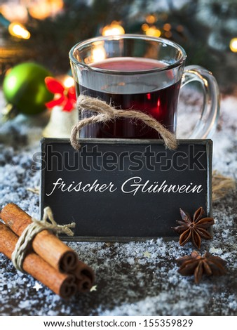 mulled wine with a tag and german text frischer gluhwein  - stock photo