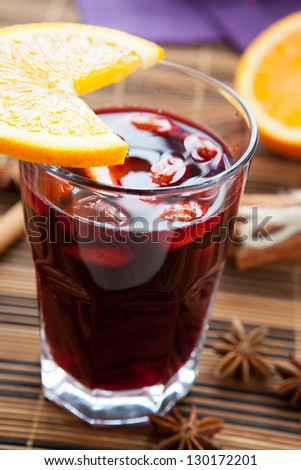 mulled wine with almonds and orange, closeup - stock photo