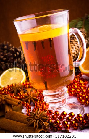 Mulled wine with cinnamon sticks and christmas anise stars - stock photo