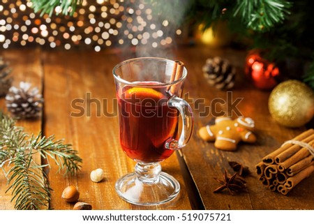 Mulled wine with citrus fruits and cinnamon on a table. Traditional winter hot drink for Christmas Eve party.