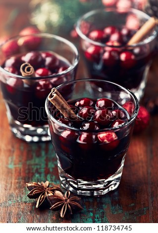 Mulled wine with cranberries and cinnamon - stock photo