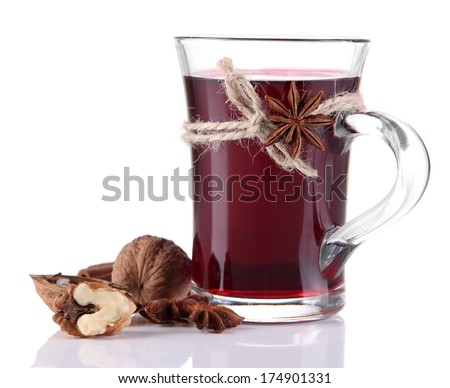 Mulled wine with nuts and spices isolated on white - stock photo