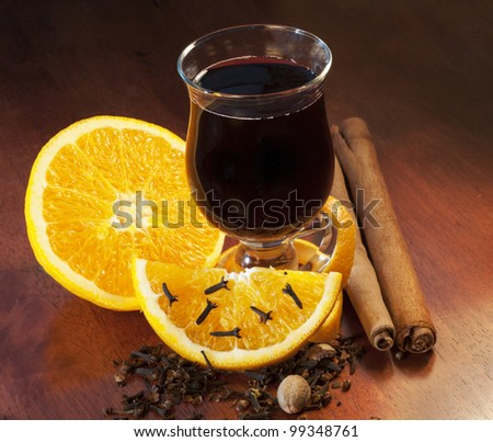 Mulled wine with orange and spices - stock photo