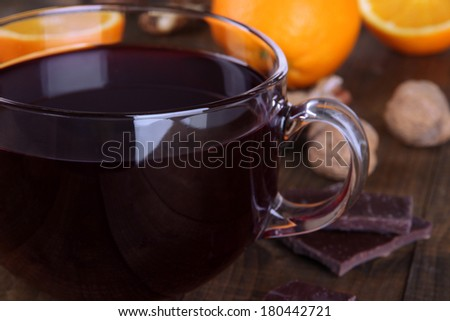 Mulled wine with orange and spices on table close up - stock photo