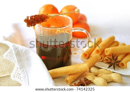 Mulled wine with rock candy and biscuits - stock photo