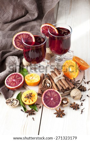 Mulled wine with slice of orange and spices - stock photo