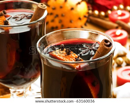 Mulled wine with slice of orange and spices. Shallow dof. - stock photo