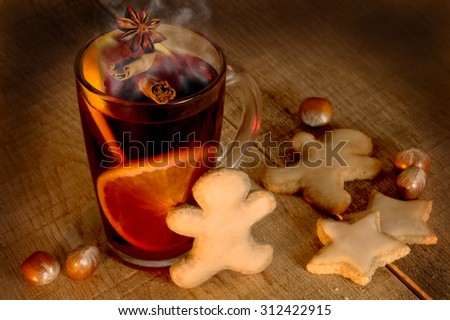 Mulled wine with spices and Christmas cookies - stock photo