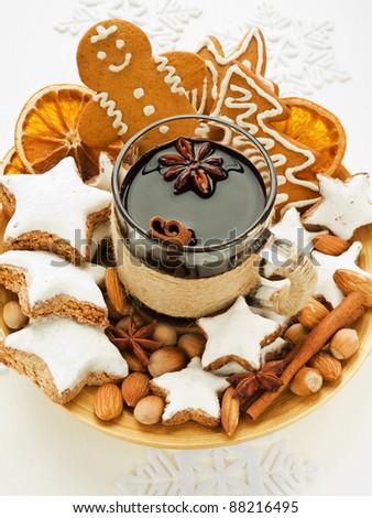 Mulled wine with spices and christmas cookies. Shallow dof. - stock photo