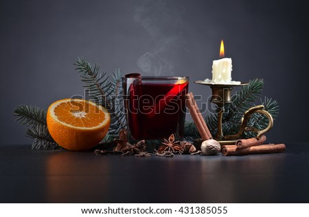 Mulled wine with spices on a black table - stock photo