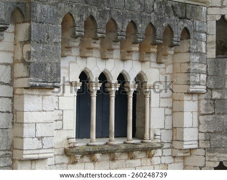 Mullioned window and arch, Romanesque church and shrines atop the citadel,  in Rocamadour, France - stock photo