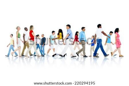 Mullti-ethnic group of people walking - stock photo