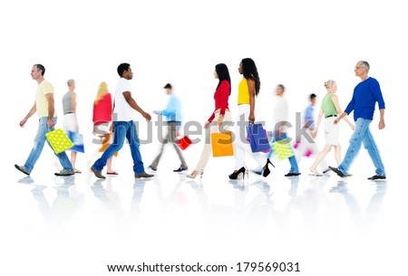 Mullti-ethnic Group of People Walking and Holding Shopping Bags - stock photo