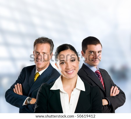 Multi aged happy business team with woman and men in a modern office with copy space - stock photo