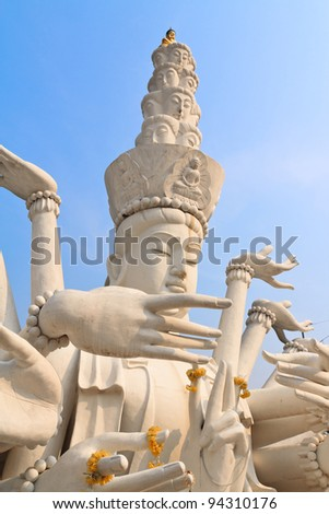 Multi armed statue in thailand temple - stock photo