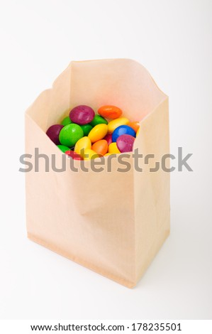 Multi color crunchy candies in a paperbag - stock photo