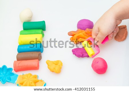 multi color dough and tool on white background - stock photo