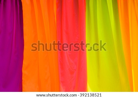 Multi color fabric in a row background - stock photo