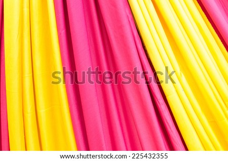 Multi color fabric in a row , pink and yellow - stock photo