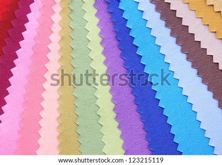 Multi color fabric texture samples. - stock photo