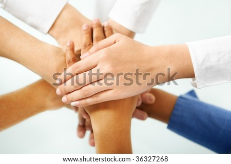 multi color hand of people hand in unity to express togetherness in community - stock photo