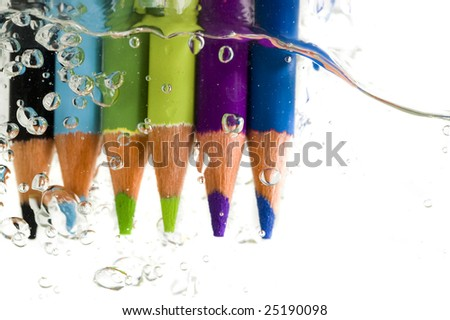 multi color pencil in the water - stock photo