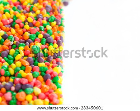 Multi color sugar dragee candies. Selective focus, main focus on the left center. Copy space on the right. Can be used as a background - stock photo