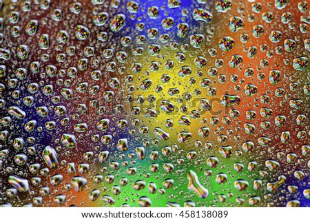 multi-colored abstract background of beads reflecting in water drops shallow depth of field