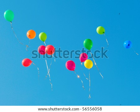 Multi colored balloons flying up in the sky - stock photo