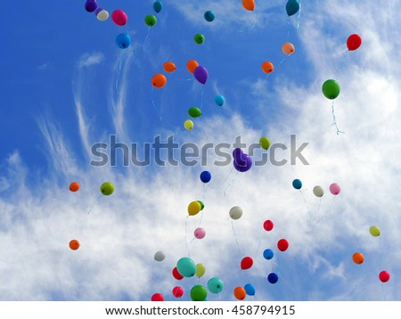 Multi colored balloons on a background of the sky - stock photo