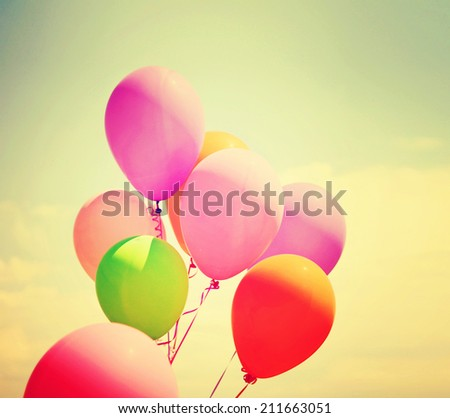 multi colored balloons toned with a retro vintage instagram like filter - stock photo