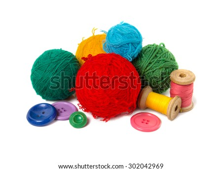 Multi-colored balls, thread and buttons. Isolated on white background - stock photo