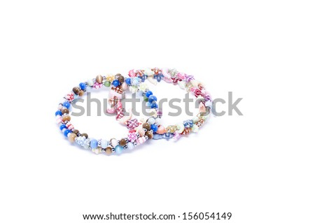 Multi-colored bracelets isolated on a white background. - stock photo