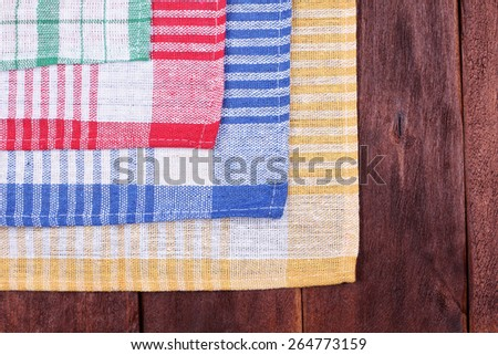 Multi-colored checkered fabric. Red, yellow, green and blue towel. Woven fiber fabric. Sewing workshop. Close up photo. - stock photo