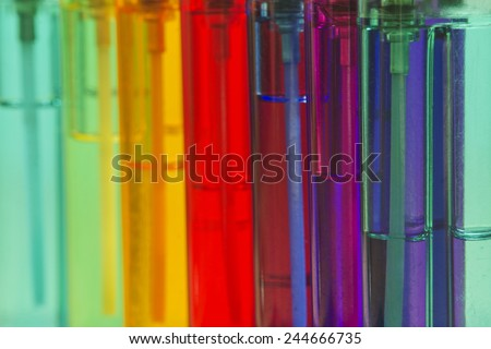 Multi-colored cigarette lighters close up.